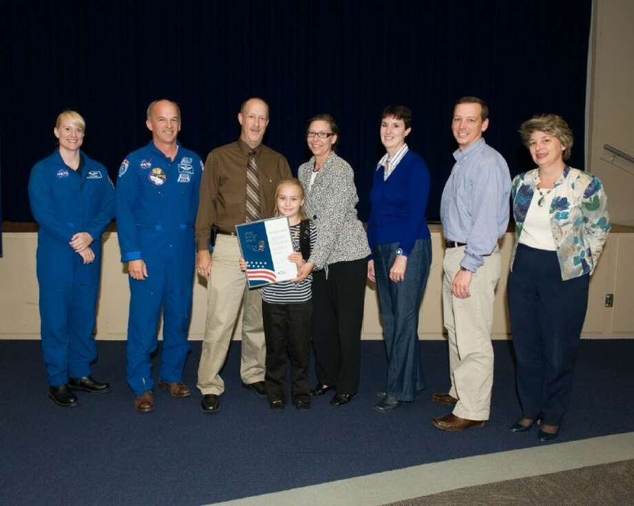 Astronauts Jeff Williams and Kathleen (Kate) Rubins presented Barrios Technology employee Scott Paul with the Silver Snoopy Award for his support of NASA's space program. Pictured from left are Rubins; Williams; Paul; Hannah Paul; Kathleen Paul; Deanna Dumesnil, Barrios Manager; Sean Fuller, NASA-JSC; and Lauri Hansen, NASA-JSC Chief of Staff. Photo: SUBMITTED PHOTO