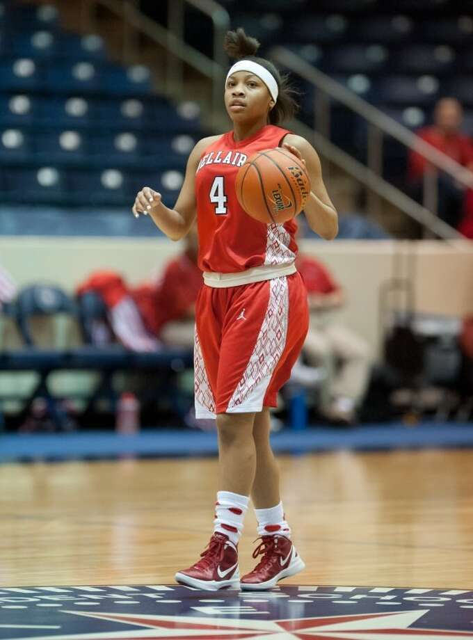 Lulu McKinney scored 11 of her 15 points in the second quarter as Bellaire pulled well ahead of Cy Woods. The Lady Cardinals won 66-47 to advance to the Region III-5A quaterfinals. Photo: Kevin B Long/GulfCoastShots.com