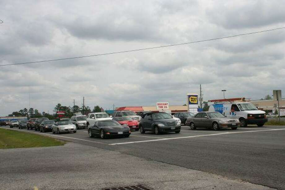 Vehicles line up at FM 1960 at Atascocita Road waiting for the light to turn green. Residents have expressed their concern about congestion at this intersection as well as at West Lake Houston Parkway.