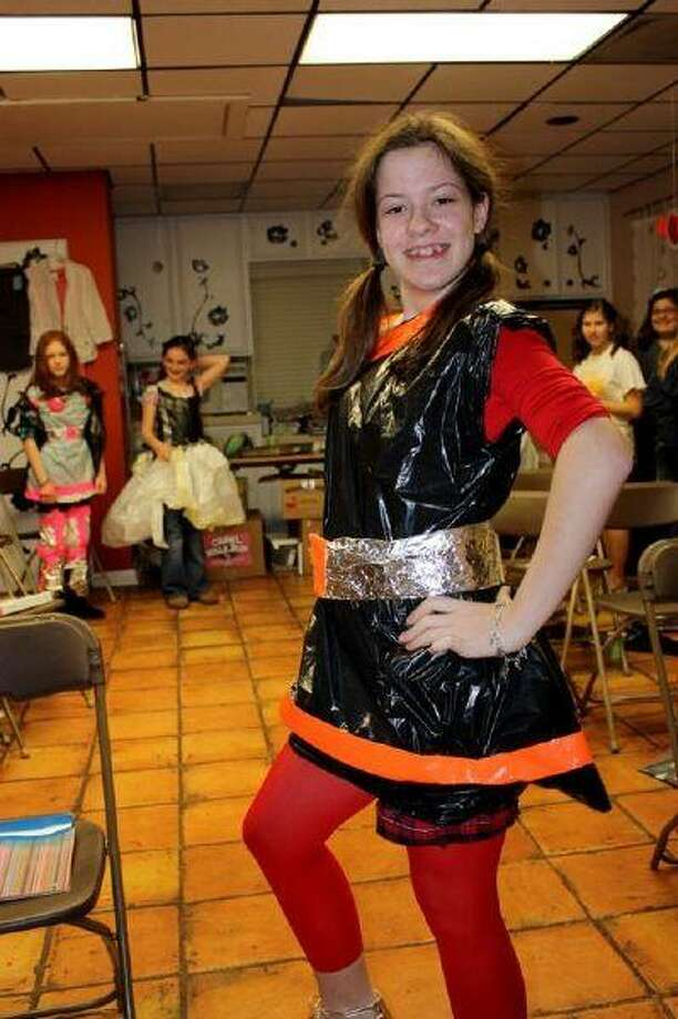 "As part of a fashion challenge along the lines of ""Project Runway,"" teams designed age appropriate outfits from plastic bags and duct tape. Pictured are Laura Gaseer and Delany Graf."