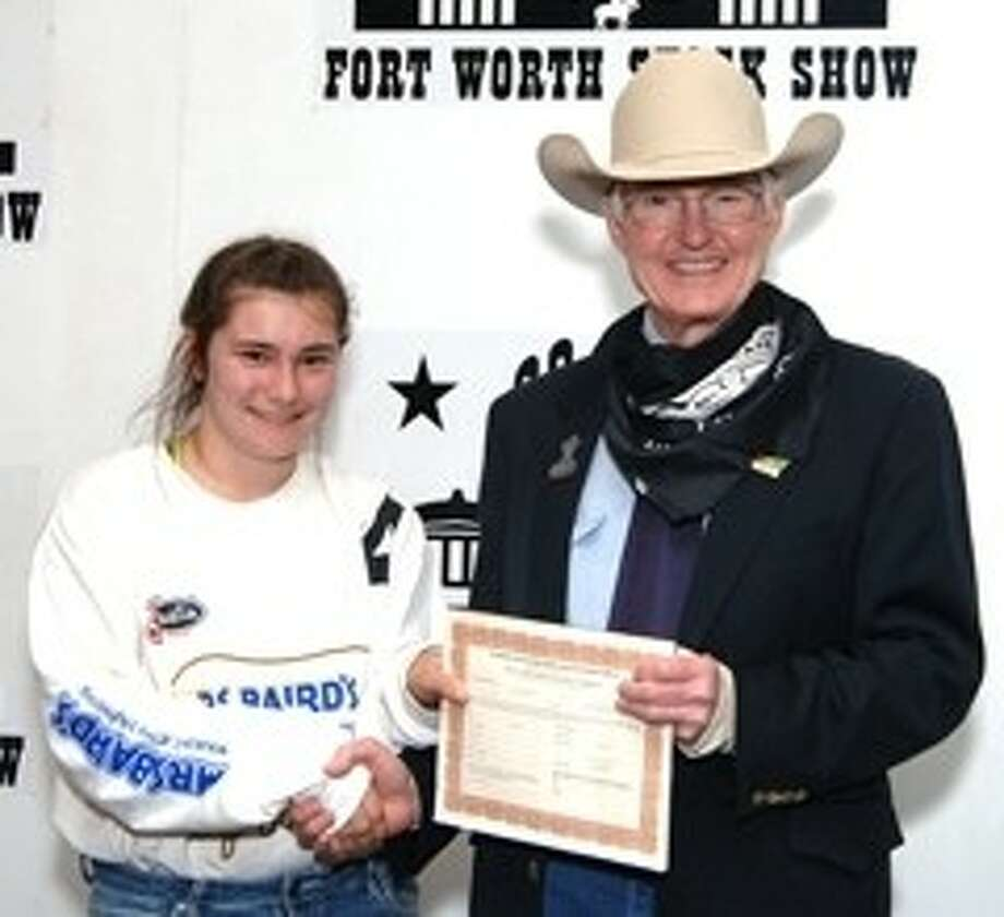 Ashley May won a 500 purchase certificate toward a registered beef or dairy heifer for a 4-H or FFA project to exhibit at next year's Fort Worth Stock Show & Rodeo. The certificate, presented by Ed Bass, FWSSR Chairman of the Board, was sponsored by Hooks Lincoln-Mercury of Weatherford, Texas. Photo: Submitted Photo