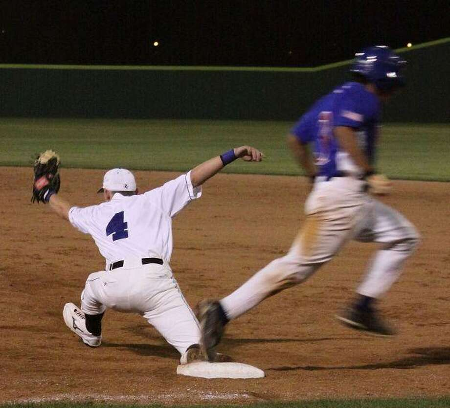 Toby Stripling stretches for an out at first base during the Eagles' 3-2 loss to Conroe Oak Ridge March 24,