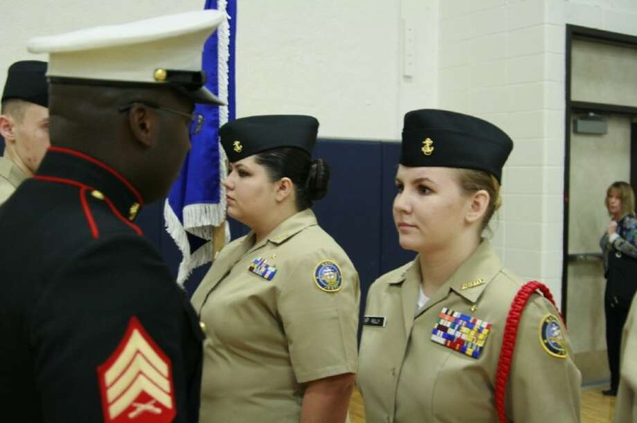 A Kingwood High School Navy JROTC cadet is inspected by a staff sergeant at the program's annual inspection Feb. 15.