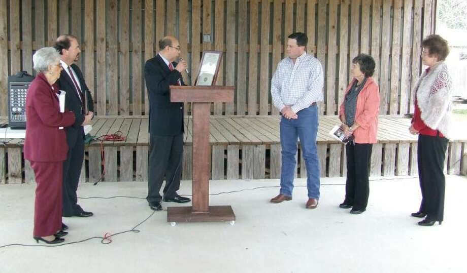 Juan Carreon, assistant vice president of public affairs for Union Pacific Railroad, center, presents Magnolia Mayor Todd Kana a proclaimation naming Magnolia an official Union Pacific Train Town on Tuesday afternoon. A ceremony was held to commemorate the occasion at The Depot in Magnolia. Pictured, from left, are Magnolia Historical Commission representative Celeste Graves, Greater Magnolia Chamber of Commerce chair Barry Tate, Carreon, Kana, Magnolia Councilwoman Anne Sundquist, and Magnolia Councilwoman Patsy Williams.