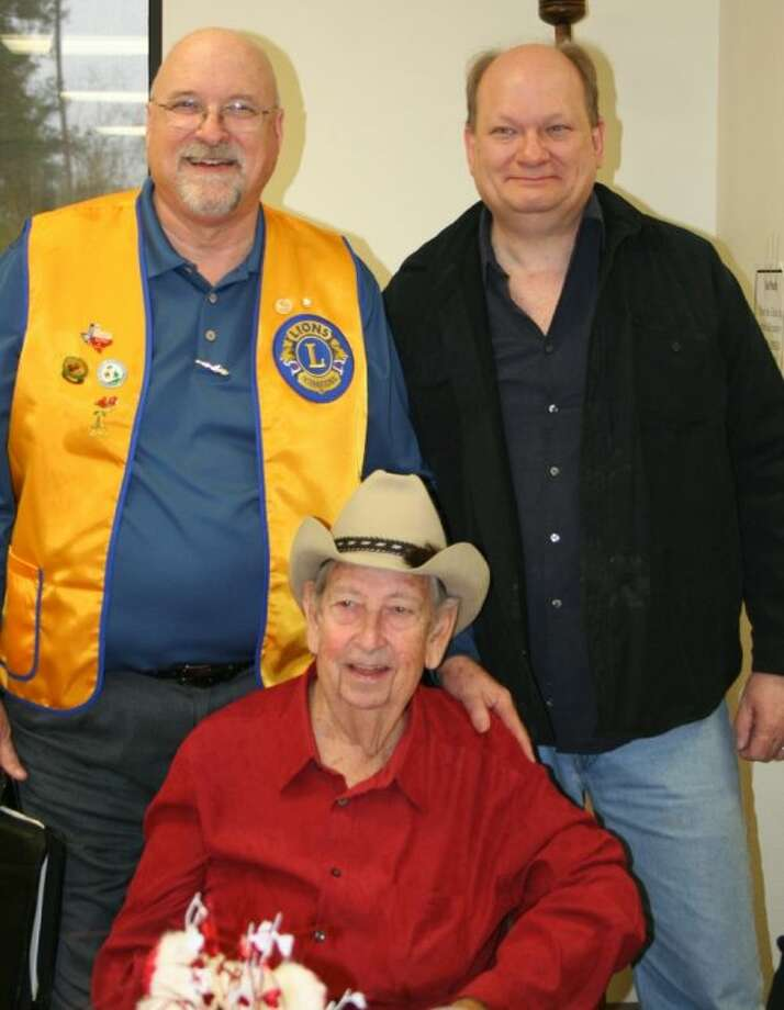 Tim Holder of the Cleveland Lions Club welcomes Christian musician Jeff Nelson and Texan storyteller and folklorist Oel Castner to the Feb. 12 luncheon for the Cleveland Lions Club, which was held at the Cleveland Senior Center. Photo: STEPHANIE BUCKNER