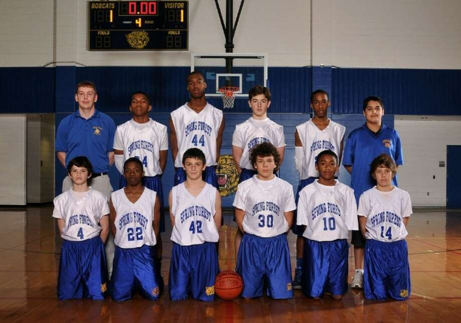 The Spring Forest Middle School seventh-grade A team won the district championship for 2011-12. Pictured are coach Ryan Harvey, manager Johnny Andrade and players Daniel Fenton, Tyriece Silas, Will Mikula, Justin Moore, Jordan Pride, Toni Pavlovic, Randall Royall, Michael Purvey, Keegan Bosco and George Wilkerson. Photo: Submitted Photo