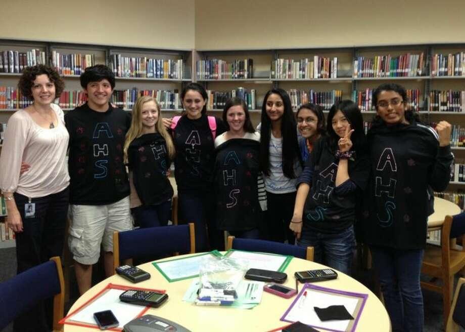 Shown is the winning Austin High School team (from left) Jill Pfeiffer, math teacher; and students Chand H., Sara T., Hoorain M., Mia Z., Raul R., Reagan J., Elizabeth M. and Emily F.