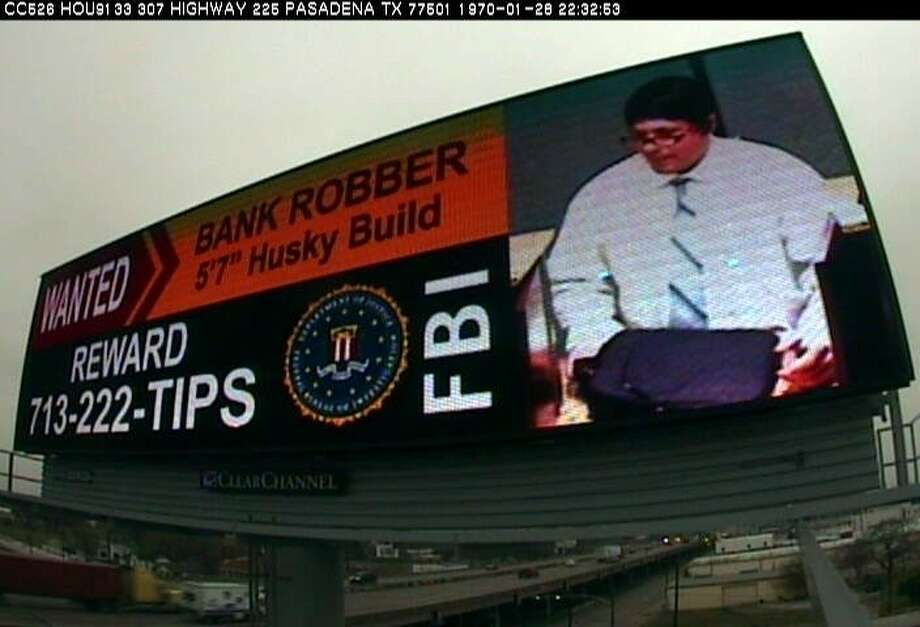 The FBI and Clear Channel are partnering to give billboard exposure to this image of the 'bad hair bandit,' wanted in two bank robberies, wearing wigs in both.