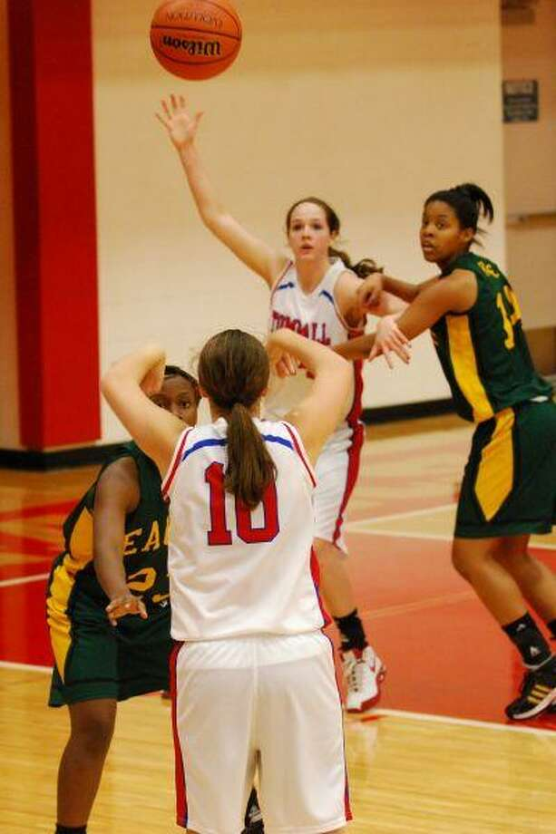 Freshman Alayna Waters (10) passes to senior Taylor Frank during Tomball's District 13-5A victory Jan. 12. Frank led all scorers with 16 points.