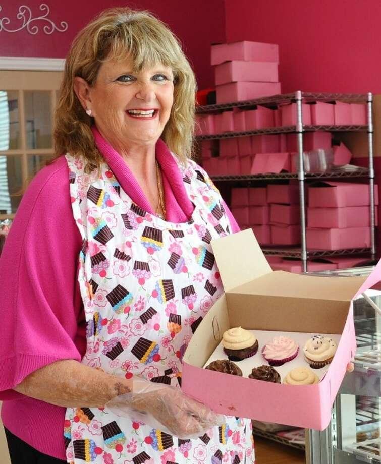 Deborah Reed shows off a box of cupcakes in her Pearland Kup n Kakes bakery. Photo: Kirk Sides
