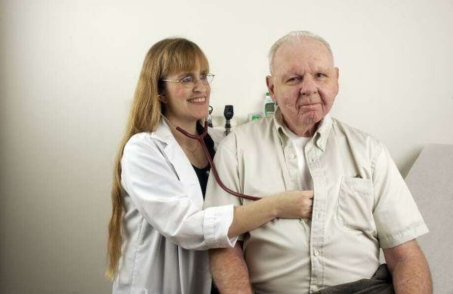 Dr. Susan P. Williams, an associate professor at Baylor College of Medicine, works with geriatic patients.