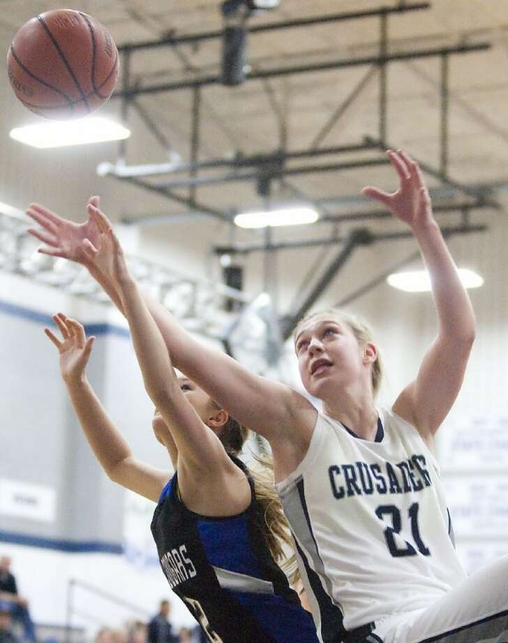 Concordia Lutheran's Emily Brooks and Arlington Grace Prep's Ellen Dixon fight for a rebound Friday at Concordia Lutheran High School. See more photos online at www.yourconroenews.com/photos. Photo: Karl Anderson