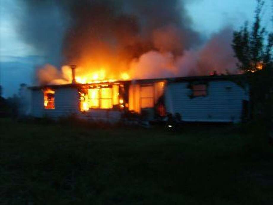 Fire fully engulfs a home on CR 2281 Tuesday evening. The home was a total loss.
