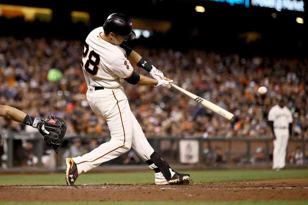 SAN FRANCISCO, CA - SEPTEMBER 27:  Buster Posey #28 of the San Francisco Giants hits a home run in the fifth inning against the Colorado Rockies at AT&T Park on September 27, 2016 in San Francisco, California.  (Photo by Ezra Shaw/Getty Images)