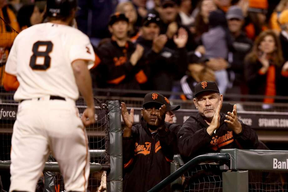 SAN FRANCISCO, CA - SEPTEMBER 27:  Manager Bruce Bochy of the San Francisco Giants claps after Hunter Pence #8 of the San Francisco Giants hit a home run in the fifth inning against the Colorado Rockies at AT&T Park on September 27, 2016 in San Francisco, California.  (Photo by Ezra Shaw/Getty Images) Photo: Ezra Shaw, Getty Images