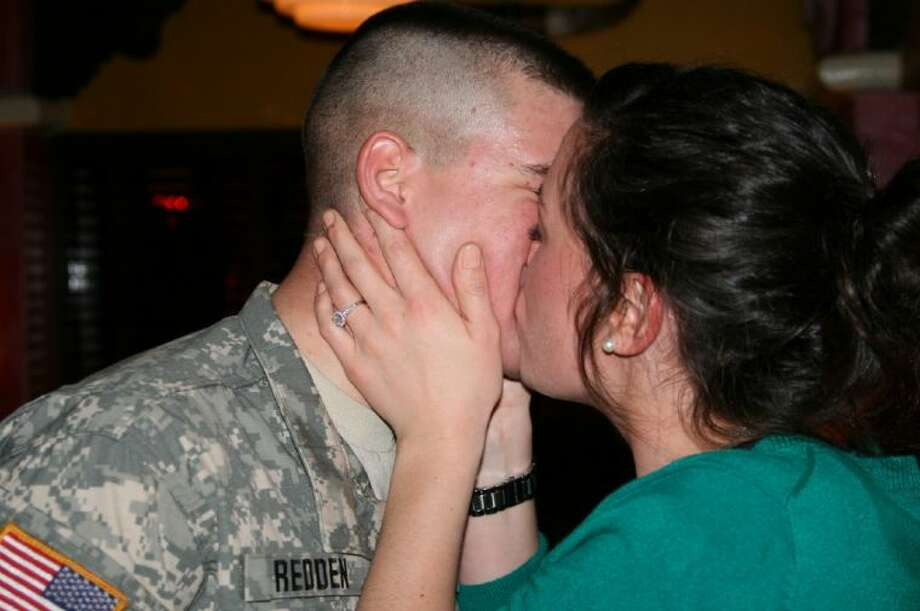 Shaun Redden and Emily Mittag celebrate their surprise proposal at Humble's Pappasito's Jan. 18. Mittag was surprised by her boyfriend with a visit and a proposal when she thought she would just be joining her family for dinner and to visit with her father, who is stationed in Germany. Redden will deploy to Afghanistan soon which makes the surprise and the proposal even more special.