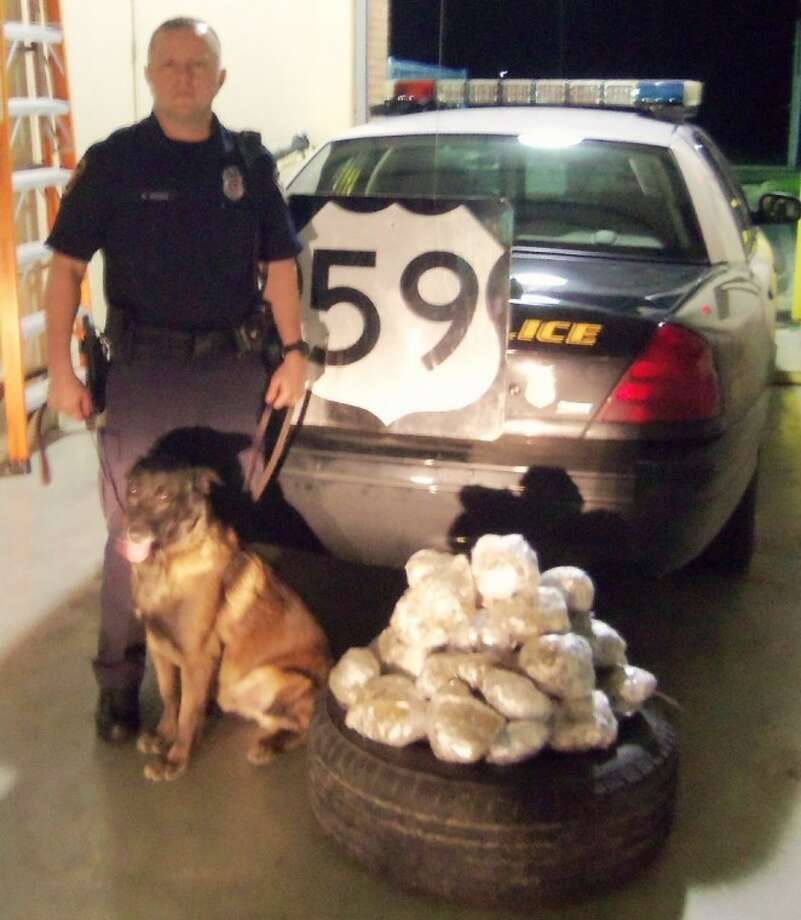 Cleveland Police Officer Paul Young (shown with K-9 officer Loco) conducted a traffic stop Thursday, Feb. 16, that led to the discovery of 24 pounds of marijuana in a spare tire of a vehicle.