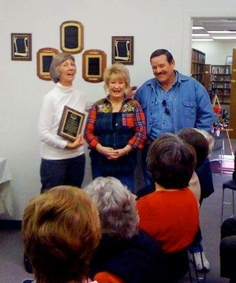 The Coldspring Area Public Library Board of Directors presented the 2009 Persons of the Year award to Mike and Ellie Johnson at the Annual Volunteer Breakfast on January 13, 2010. Pictured above are Library Board President Manda Lively, Ellie Johnson and Mike Johnson.