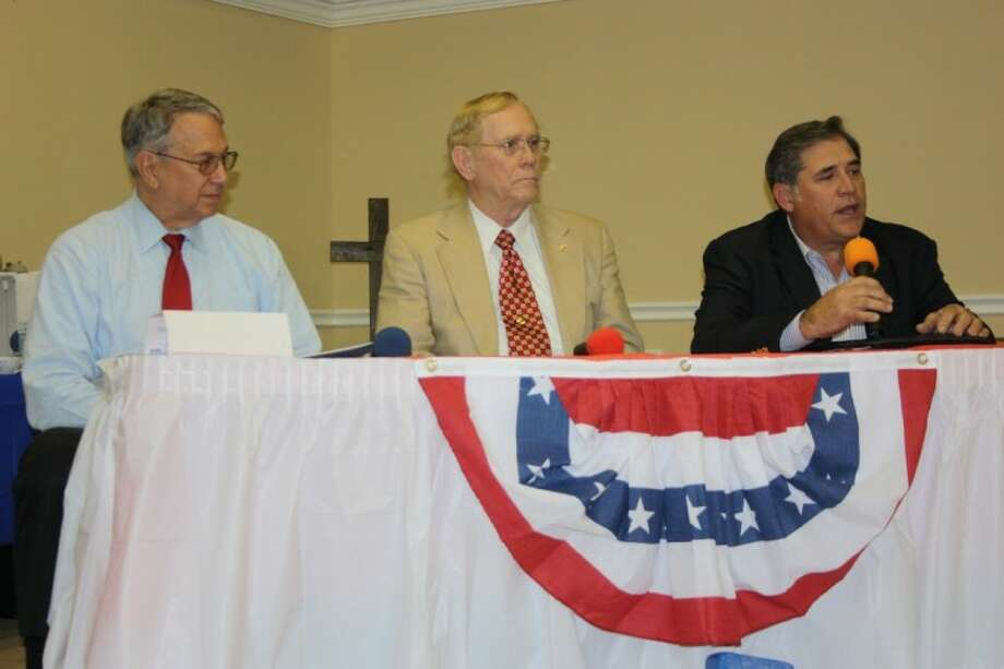 The candidates for Liberty County Sheriff discussed their qualifications, experience and goals at the Tri-County Texas Tea Party candidate forum. Shown from left to right are Precinct 1 Justice of the Peace Bobby Rader, Will Cox, and incumbent Sheriff Henry Patterson. Photo: MELECIO FRANCO