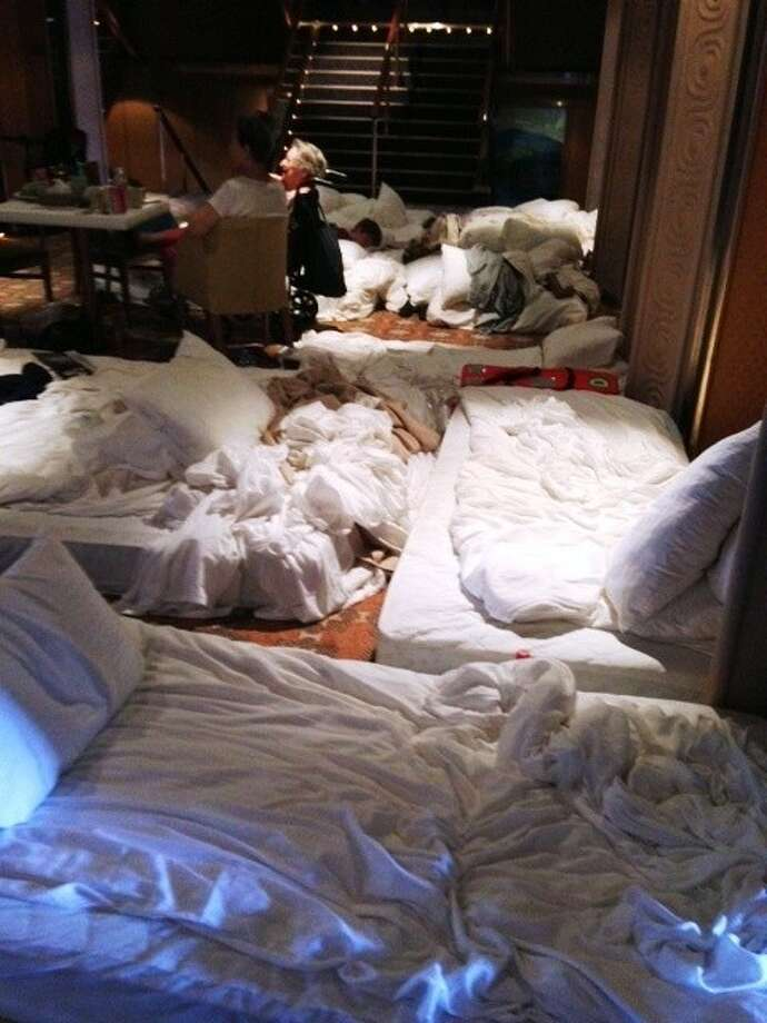 The Olsavskys slepts on makeshift beds along with Triumph cruise ship passengers after abandoning their cabin because of poor ventilation and unsanitary conditions.