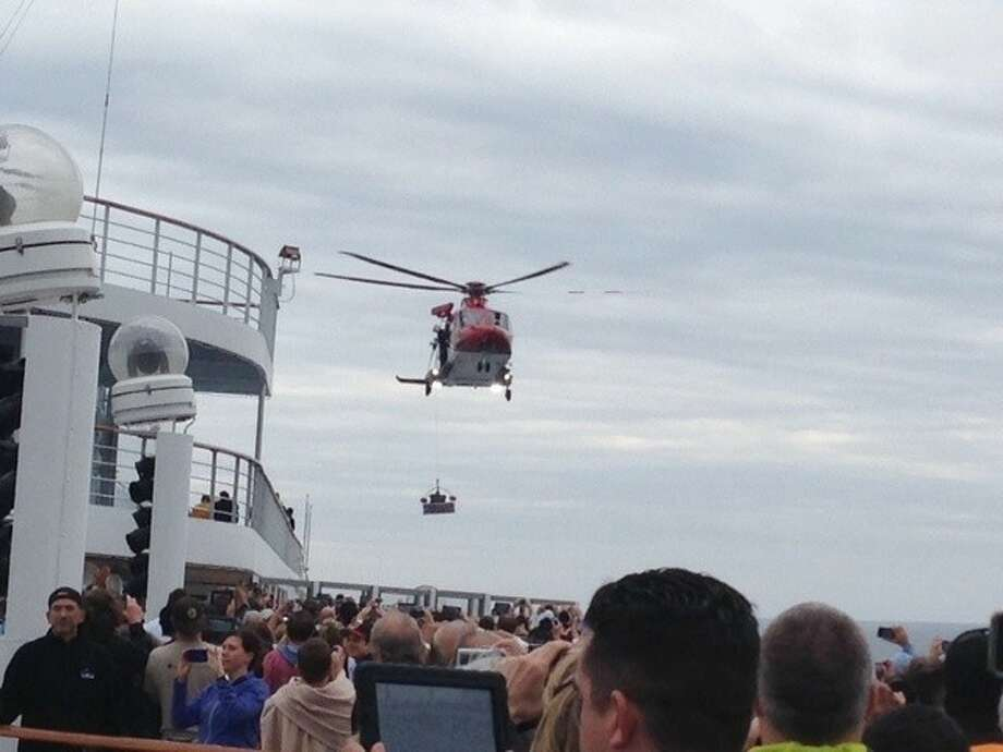 A Coast Guard helicopter drops provisions for the passengers and staff of the cruise ship Triumph after the ship was stranded for seven days in the Gulf of Mexico. Photo: MARY JO OLSAVSKY