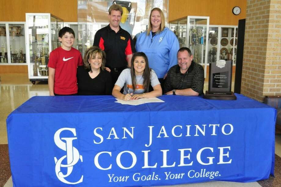 Brittany Weiler will continue her education and volleyball career at the University of St. Thomas. Pictured with Weiler (center) are her family members (first row, left to right): James (brother), Kim (mother), and Mike Weiler (father); (back row, left to right): Trent Herman, University of St. Thomas volleyball head coach; Sharon Nelson, San Jacinto College volleyball head coach.
