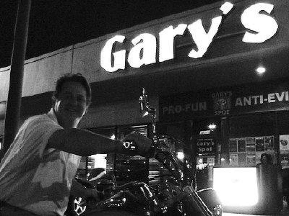 Owner Gary Crawford cruises in on his hog to catch Soulbound's performance on Wednesday, April 1. / @WireImgId=746842
