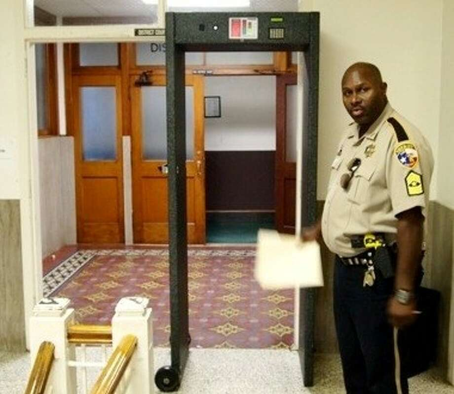 Sgt. John Davis, the bailiff for the 75th District Court, says metal detectors outside the courtroom are working but could use some updating. Photo: CASEY STINNETT
