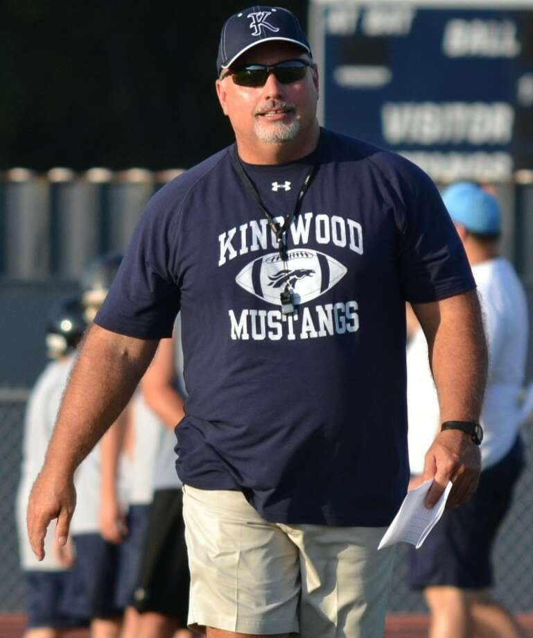 Dougald McDougald, seen here at a Kingwood football practice in August, will retire as the Mustangs' head coach on March 9. Photo: Photo By Stephen Whitfield/HCN