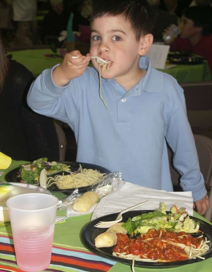 St. Luke's member Jace de los Santos enjoys last year's spaghetti. (Photo submitted by St. Luke's United Methodist Church)