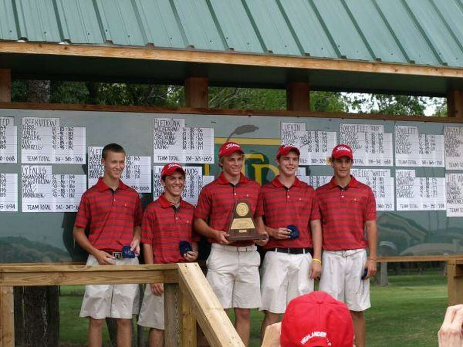 The Woodlands boys varsity golf team shows off their championship trophy after winning the Region II-5A tournament at Twin Rivers Golf Club in Waco Friday.