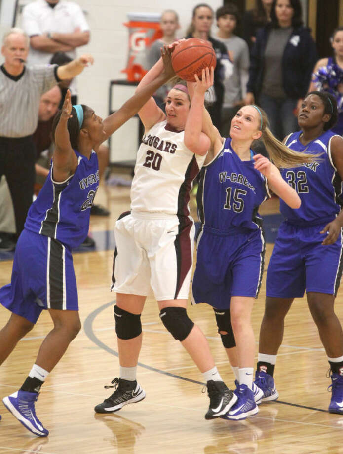 Cinco Ranch's Angie Moore gets surrounded against Cy Creek in the Girls Basketball Area Playoffs at Taylor High School in Katy. Cy Creek won the game 43-39. (Photo by Alan Warren) Photo: Photo By Alan Warren