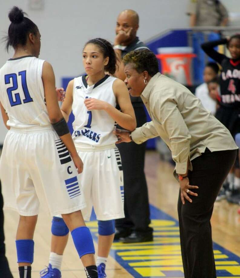 Clear Springs head coach Pam Crawford confers with Lady Chargers Ryshinique Ball (21) and Brooke McCarty (1) during Saturday's 71-59 win over Port Arthur Memorial. Photo: KAR HLAVA
