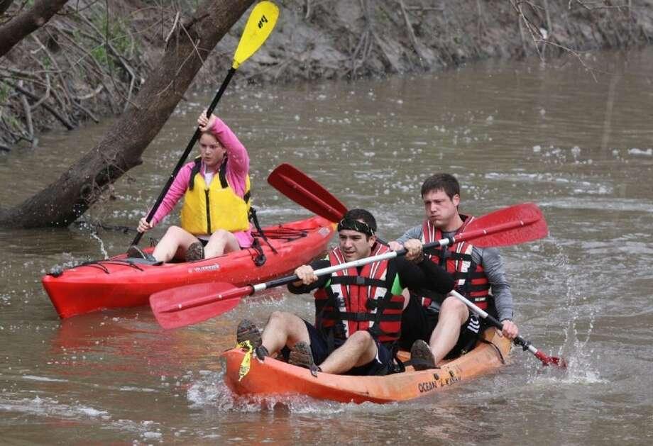 Participants paddle down Langham Creek during the Bayou Adventure Race. Photo: Alan Warren