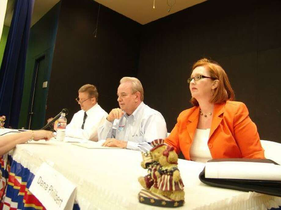 Pasadena mayoral candidates, from left, David Stroder, Johnny Isbell and Dana Philibert field questions during a debate on Monday.