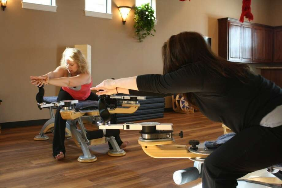 Instructor and studio owner Pam Blangy gives a client Gyrotonic training on the methods signature equipment. Gyrotonic method incorporates key principles from yoga, dance, gymnastics and tai-chi to stretch muscles and strengthen joints.
