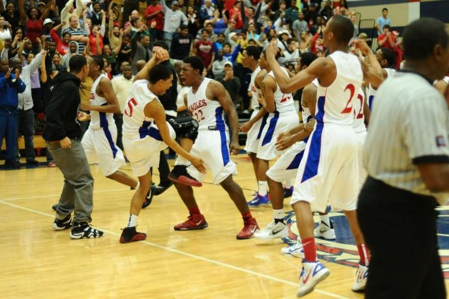 Dawson players celebrate following their 123-115 quadruple overtime win against Manvel that earned it the district's top seed in the playoffs. Photo: KIRK SIDES