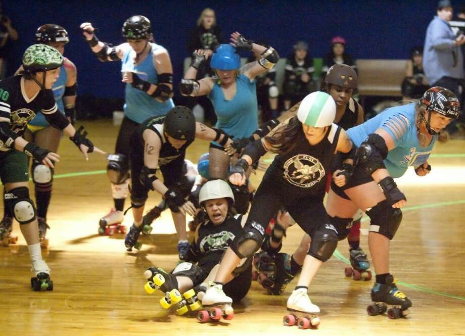 Northside Fury Roller Derby takes a fall during the bout with Rocket City Roller Girls Sunday at Champions Roller World in Spring. Photo: Karl Anderson