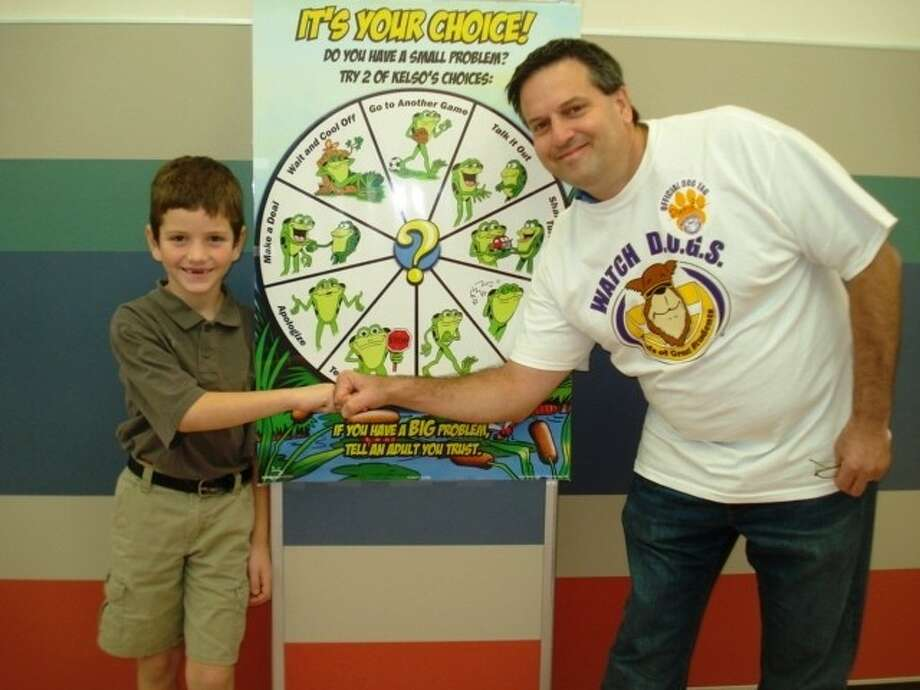 Fathers volunteer for Watch D.O.G.S. Program to show support of the students and staff at Wilder Elementary. Photo: AISD