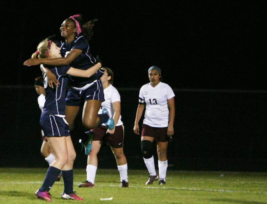 Tomball Memorial's Tori McCarter leaps into the arms of teammate Karley Pecosky after scoring a goal against Magnolia West during Friday night's District 40-4A game. The Lady Wildcats led 9-0 at halftime. To view or purchase this photo and others like it, visit HCNpics.com.