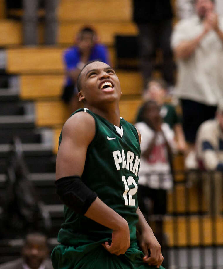 Jordan Powell celebrates following Kingwood Park's 53-46 win over C.E. King in a District 19-4A playoff tiebreaker game on Feb. 15, 2013, at Atascocita High School. Photo: Photo By Amanda J. Cain