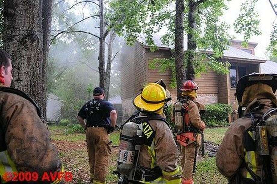 Atascocita fire fighters responded to a house fire caused by a lightning strike in the 19000 Hurst Wood Drive April 12.