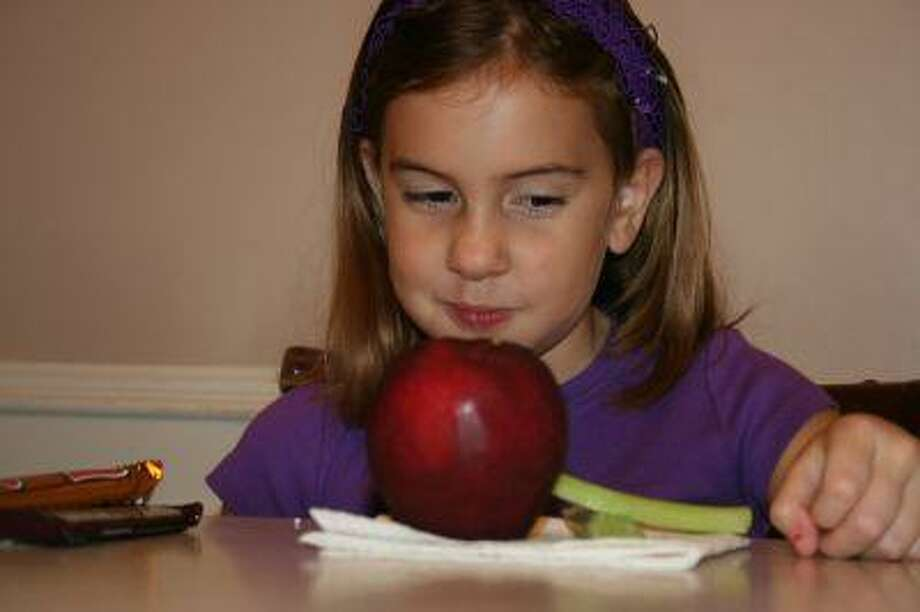 Often times there's a power struggle between parents and children when it comes to eating healthy. Experts suggest compromising and finding a middle ground.