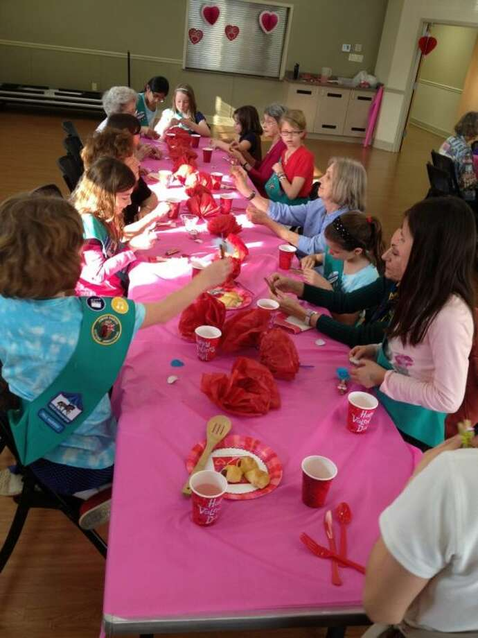 Girl Scout from Troop 25239 had a lovely time hosting a Valentine's Day party for seniors at the West University Senior Center.