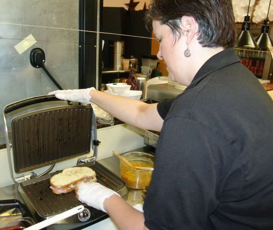 Owner Kim Oravetz making sandwiches last year at the Texas Tea Room & Café. Photo: JEFF NEWPHER