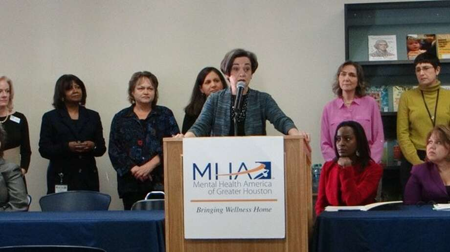 Gwen Emmett, Board Director at Mental Health America of Greater Houston announces legislative and school district recommendations that address mental health and substance abuse issues among youth at the MHA Harris County School Behavioral Health Initiative press conference on May 14th .