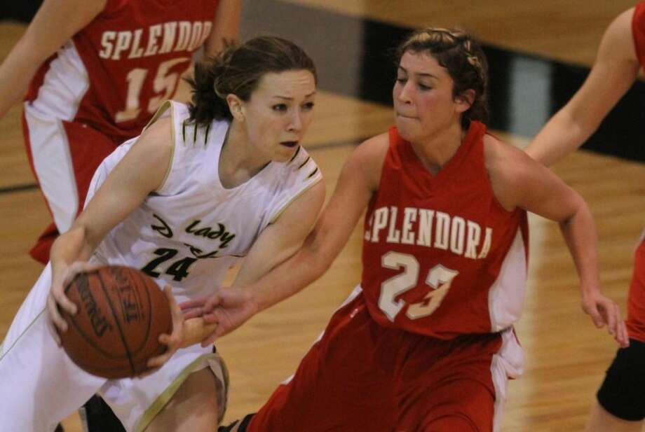Laura Kerr (24) of Liberty drives the ball against Lynze Brode (23) of Splendora. Kerr was named Offensive Player of the Year. Brode made the all-district first team.
