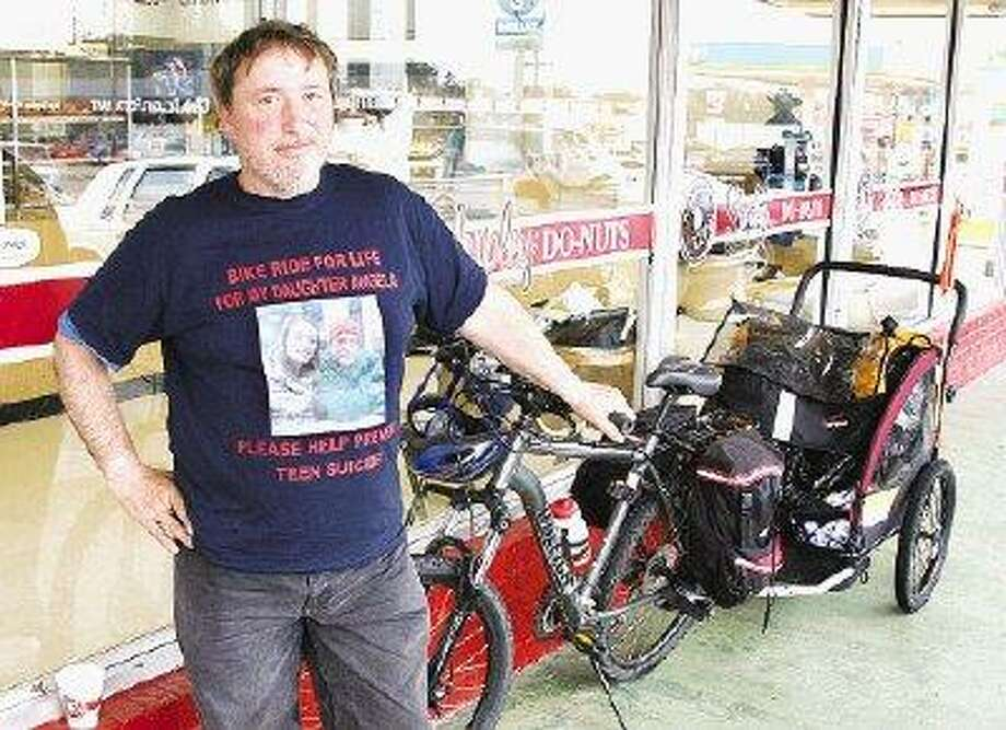 David Alexander, of Durand, Mich., made a stop in Conroe Friday on his yearlong, 6,700-mile bike journey to promote awareness of teen suicide.