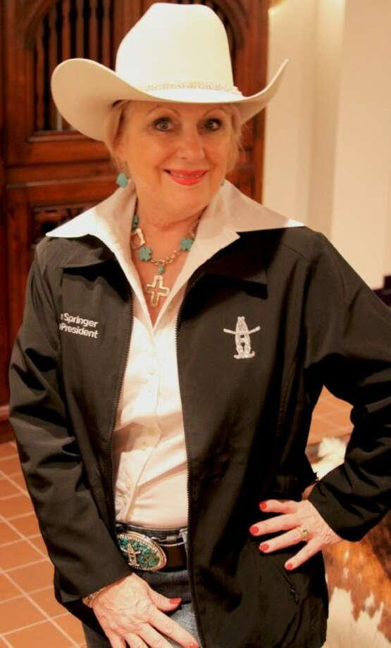 Houston Livestock Show and Rodeo Vice President Pam Springer shows off her HLSR jacket. The HLSR kicks off on Tuesday. The Downtown Rodeo Parade and ConocoPhillips Rodeo Run are Saturday.