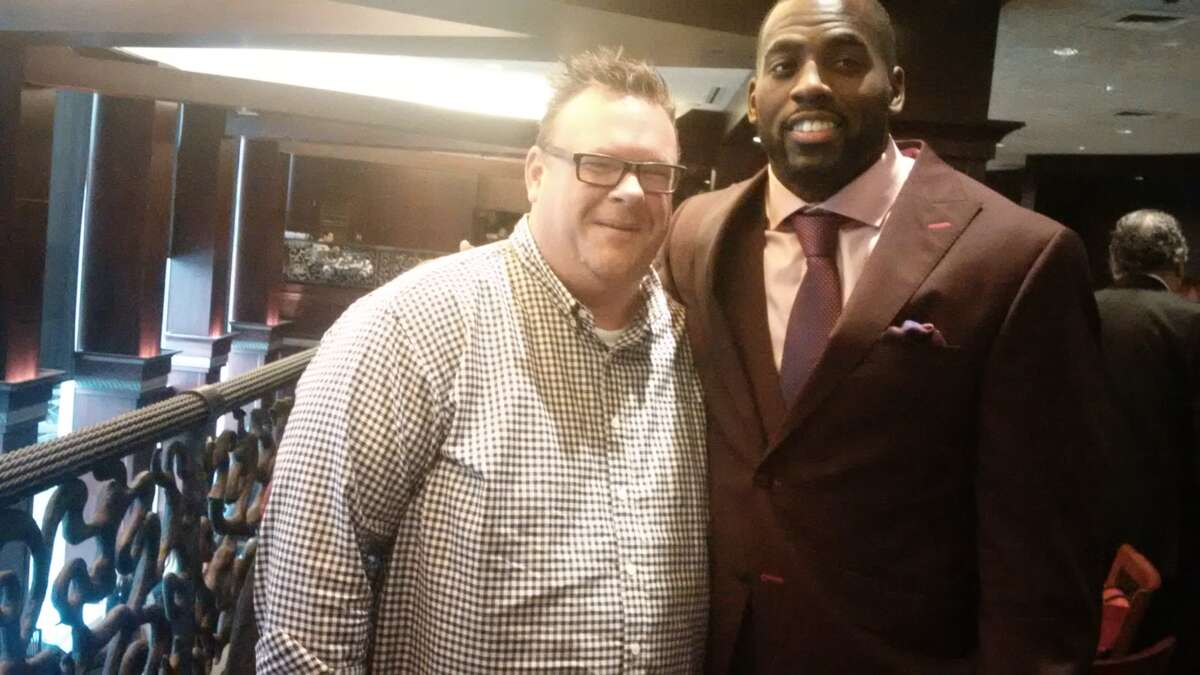 Texans linebacker Whitney Mercilus and Underbelly' s Chris Shepherd at Mercilus' charity event at Del Frisco's at The Galleria